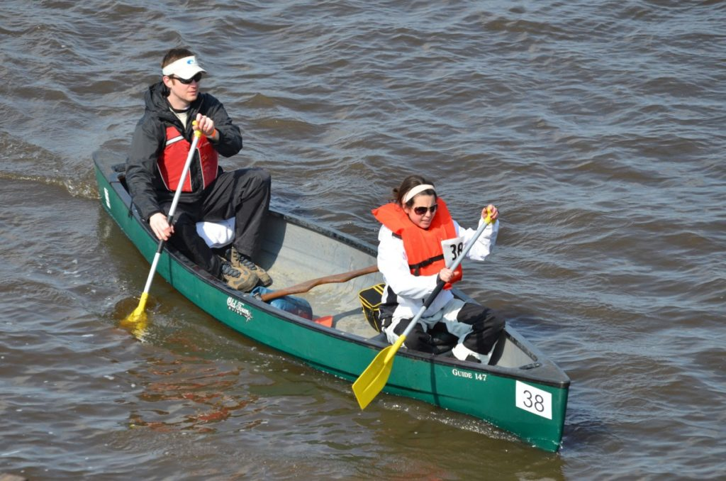 canoeing, couple in canoe, couple canoeing, canoeing for couple